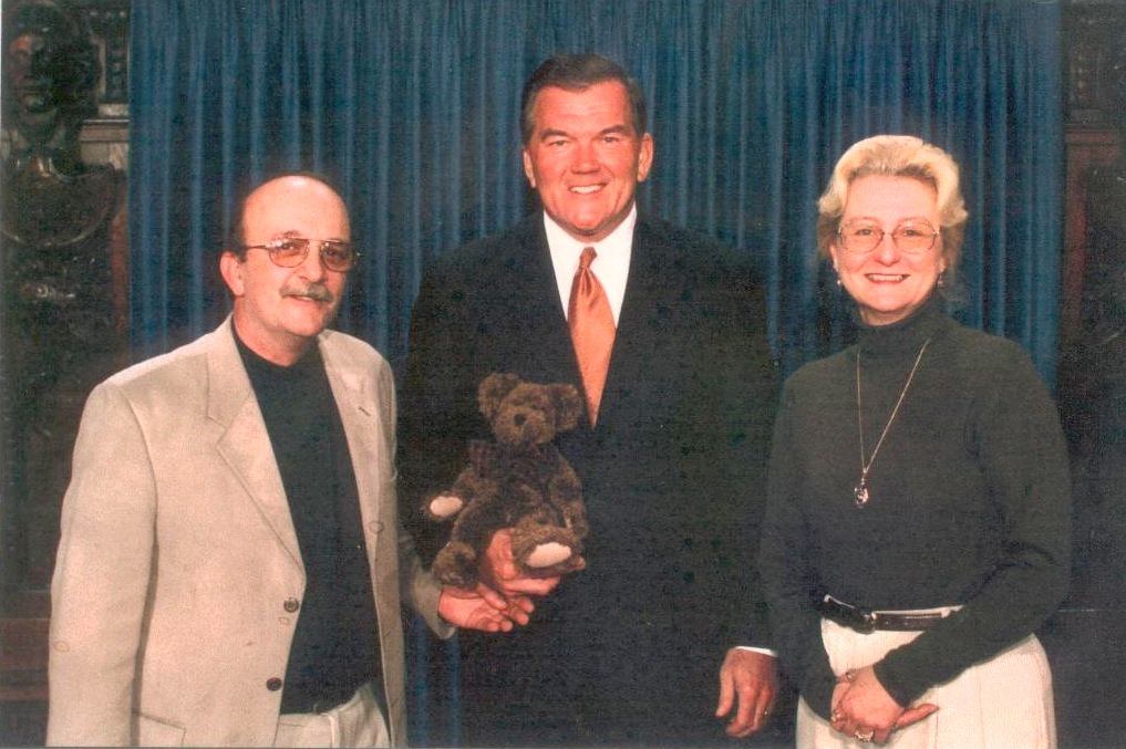 "PACFI's Bob and Linda Derr present Governor Tom Ridge with a Burke P. Bear.  Ridge, who became the nation's first Director of Homeland Security, noted:  ""Not many people know that I have a private teddy bear collection, and Burke will be a part of my collection."""